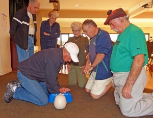 """Canyon Lake Emergency Preparedness Committee volunteers teach fellow residents the benefits of """"hands-only"""" CPR."""