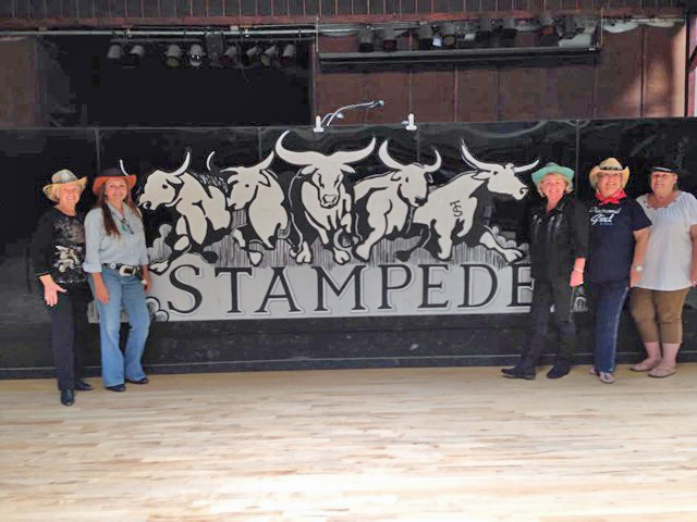 "Pictured at top are Lynn Trampush (Stampede owner), Lyne Hall, Rose Marie Hand, Jan May and Candy Petersen, who put together a buffet for the attendees. The club will be ""dark"" for the summer."
