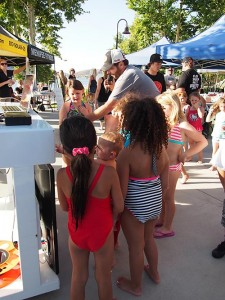 DJ Mike Shroyer always attracts a crowd of kids at Fiesta Day. Photo by Donna Kupke