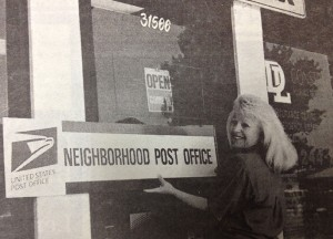 A picture in the June 2, 1995 issue of The Friday Flyer shows Debby putting up the sign designating Pack Wrap and Post as an official U.S. Post Office.(File photo)