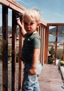 A young Kasey stands on the deck of his childhood home on Chaparral Dr.