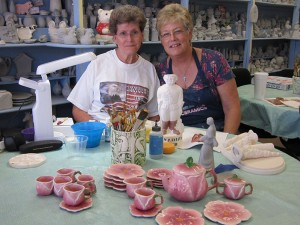 Patty is pictured with a new customer, Kay Klein, who has been busy painting gifts that include a 21-piece tea set and and 23-piece chess set. This is the time of year many customers start painting gifts and decor for the holidays.