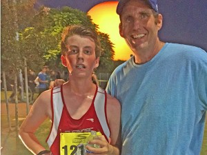 Spencer stands with his dad, Bill Massicot, after a race. Photo provided by Spencer Massicot.