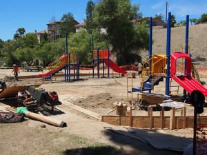The playground at Sierra Park is more extensive. Installers expect to have it completed on schedule by next Friday, August 14.