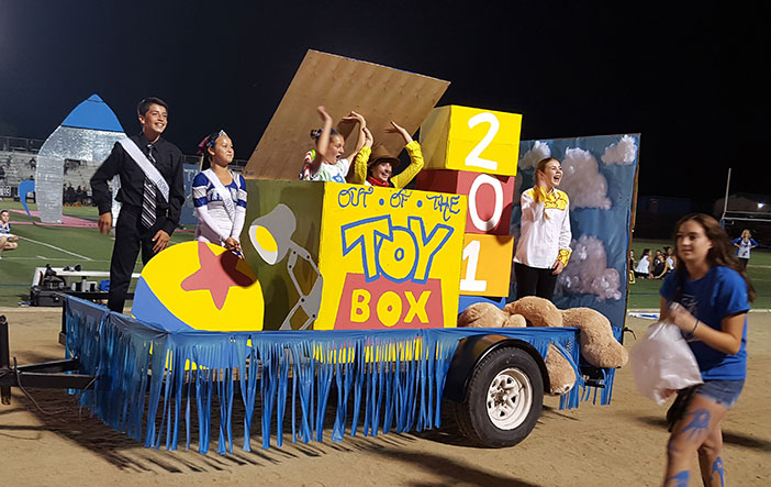 "The Homecoming Halftime Parade freshman float theme was ""Out of the Toy Box."""