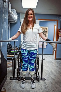Amy Martinez practices walking with her new prosthetics. The young Canyon Lake mother had to have both feet and one hand amputated after she suffered septic shock in February. Photos provided by Amy Martinez
