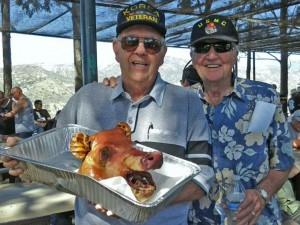 Jack Wamslley and Gene Jones enjoyed trying all different types of barbecued wild game at a recent carity dinner in Irvine. Here they show off the boar's head.