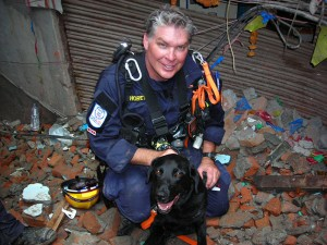 Los Angeles County Fire Captain Ron Horetski and his search dog, Pearl, take a break during their search and rescue mission in Kathmandu, Nepal, following the 7.8 earthquake that rocked that nation on April 25. The canine team is a member of the Urban Search and Rescue California Task Force 2 (CA-TF2) that deployed with America's Disaster Assistance Response Team (DART). Photos provided by Ron Horetski