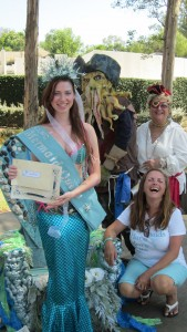 Newly crowned Mermaid Queen Karina Bowen is joined by Davy Jones, Woman's Club President Jan May and Mermaid Festival organizer Lyne Hall, lower right. Photo by Sharon Rice.