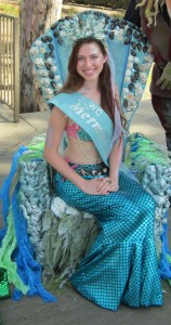 Queen Karina reigns from the Mermaid Throne created by Lyne Hall.