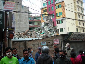 In spite of damages to a number of buildings like that at right, Ron says he was surprised to see businesses up and running again within 24 to 48 hours after the earthquake.