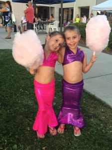 David Guthery's granddaughters, mermaid twins Gabriella and Aubrey Lou, enjoy themselves at Taco Tuesday and are a good illustration of what everyone is invited to wear at the Mermaid Festival. Photo by David Guthery