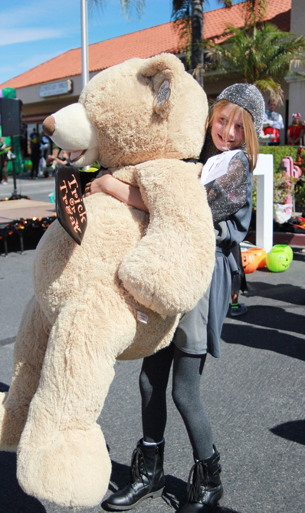 Nicole Kell, right, was the Treasure Map grand prizer winner of the giant teddy bear