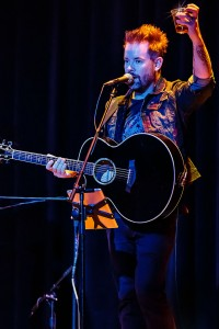 David Cook offers a toast to Canyon Lake during one of his performances last Saturday. Photo by Mike Clary.