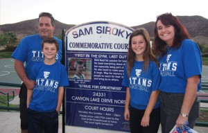 In November 2014, there was a ceremony to name the East Port basketball courts in honor of Sam Siroky, the 15-year-old killed in a bicycling accident the previous July. His family poses with the new sign.