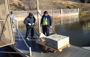 The Grounds crew recently added new cement anchors to the pulley system on the deck of the rental dock at the Lodge. This prevents the docks from moving side to side in windy situation.