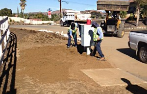 The Grounds crew had a big job cleaning up a mud flow on Black Horse Dr. on January 12. Photo by clpoa