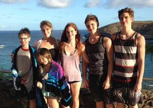 Six out of seven of the Bryant kids are pictured on a trip to Hawaii.
