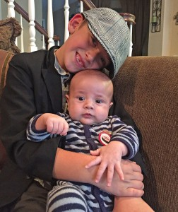 Locklin, now 4 months old, gets a hug from big brother Cameron.