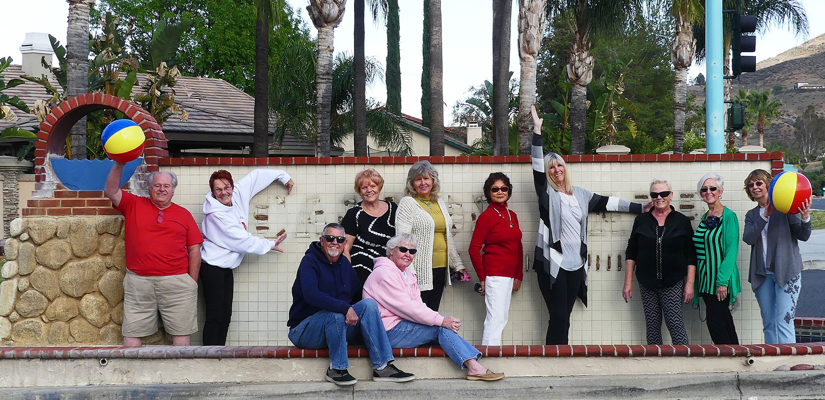 Several members of the Senior Chair Volleyball Club also got their picture taken at the entry monument, though the gold letters had already been removed. Two members used their arms to indicate the 'C' and the 'L' of Canyon Lake in the photo taken by Bert Barbay.