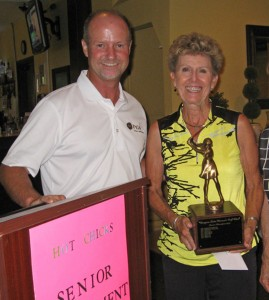 Inga Loy, overall winner of the Senior Ladies  Golf Tournament, is congratulated by Golf Pro Pat Kemball.