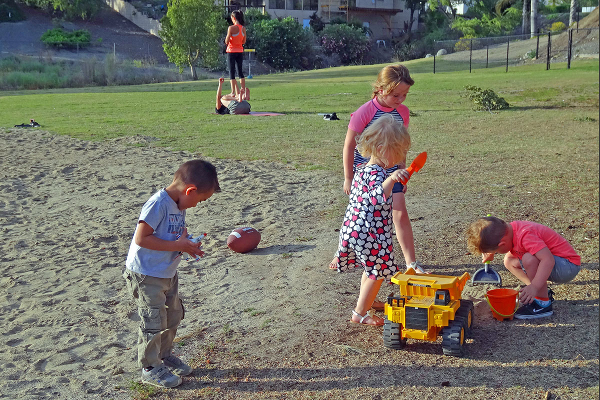 Adam Steed, at left, asks to come to the park every day, says his mom. Here he joins Zella and Rylee Warnock, who are already playing with new friend Hunter Simison. Photos by Donna Kupke.
