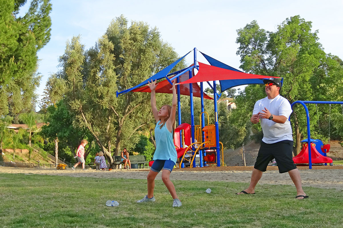 "Dan Iman says he brings son Jaden and daughter Dalani to the park every day, ""We come play, then go home and eat dinner!"" On this day, the three were having a great time playing catch football."