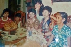 Carmelita Kubota stands behind her auntie, her eldest sister and her mother, Nicolasa Cruz.