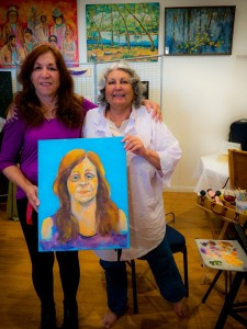 Marilyn Lafferty won the opportunity to have Therese Daniels, Paint her portrait. Photo by Robert Kurtz
