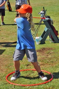 A youngster learns new skills at Junior Golf Camp.