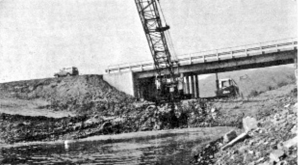 In 1971, tons of dirt and rock were removed from beneath the bridge to Treasure Island to open up the waterway for boat passage. This photo appeared inthe Canyon Lake Lighthouse publication, published monthly in Wildomar by Ann S. Holdan.