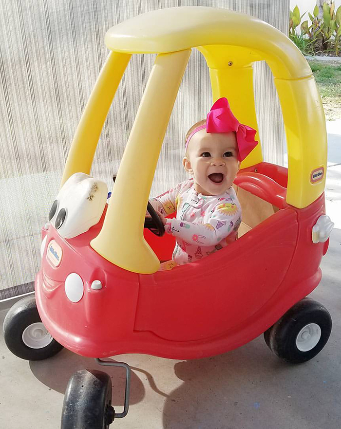 "Eight-month-old Giselle June Walda takes her first try at driving. ""She was jealous of watching her three-year-old brother Christian drive it,"" says her mom Brittany Walda.   Photo provided by Brittany Walda"