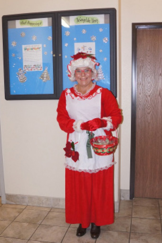 Last year Mrs. Claus eagerly awaited for the kids with a basket full of candy canes.