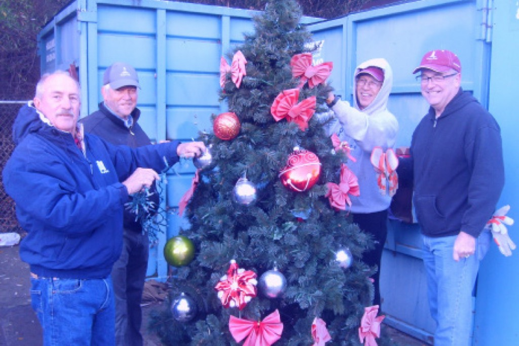 The Canyon Lake Men's Golf Club adorned its tree with big red bows and bulbs. The tree will be displayed on the median at the Main Entrance along with all the other club trees. Photo provided by Sam Theodora.