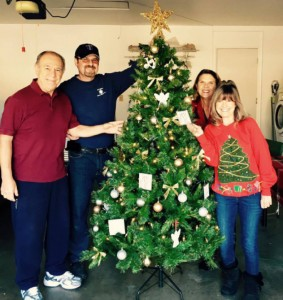 Members of the Canyon Lake Bible Club decorate the club's first holiday tree. The tree will be placed near the main entrance along with the other club trees. Pictured from left are Vince Bautista, Steve Martin, Jackie Hodge and Lynn Allen.