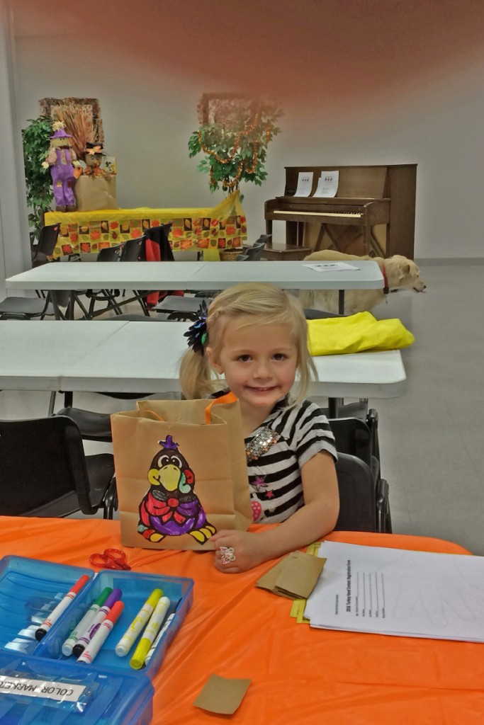 At the November 18 Preschool Story Time, preschoolers decorate paper bags with turkey figures they  cut out from material supplied by Miss Ginny. Story time, dance and singing were among the other activities the preschoolers enjoyed.