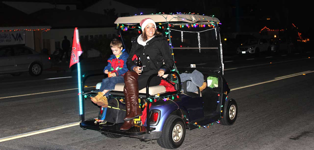 Decorate a golf cart, join in on the Golf Cart Parade | The Friday on magic sleigh, shopping cart sleigh, car sleigh, replica sleigh, dale earnhardt 3 santa sleigh, customized sleigh, atv sleigh, golf santa rosa beach florida, golf decorating ideas,