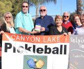 Pickleball Club presents charitable donation
